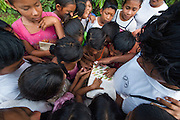 Fairview Amerindian Village Children who belong to the Fairview Wildlife Club<br /> Iwokrama Forest Reserve<br /> GUYANA<br /> South America