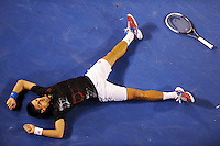 Tennis superstar Novak Djokovic slumps to the ground after winning a long rally against Rafael Nadal in the final of the 2012 Australia Open at Rod Laver Arena. He eventually won the match and it was the longest ever final in Grand Slam history. (Copyright Michael Dodge/Herald Sun)