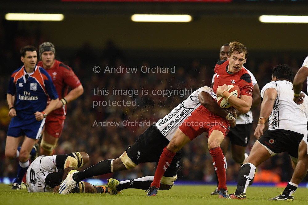Liam Williams of Wales is stopped. Dove Men series 2014, autumn international rugby, Wales v Fiji at the Millennium Stadium in Cardiff, South Wales on Saturday 15th November 2014.<br /> pic by Andrew Orchard, Andrew Orchard sports photography.