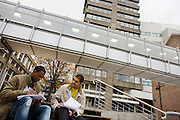 Two students talk while studying outside at London Metropolitan University's Holloway Road campus.