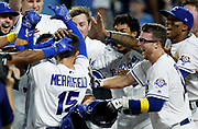 Kansas City Royals' Whit Merrifield (15) is mobbed by his teammates at home plate after hitting a game-winning home run in the ninth inning of a baseball game against the Baltimore Orioles at Kauffman Stadium in Kansas City, Mo., Saturday, Sept. 1, 2018. The Royals beat the Orioles 5-4. (AP Photo/Colin E. Braley)