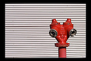 Red water Hydrant on a corrugated silver background