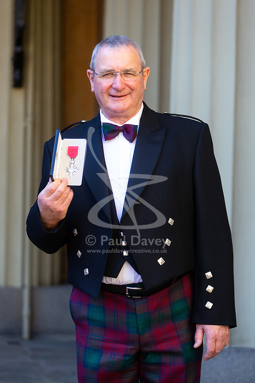 Mr. William Deans, Lifeboat Operations Manager, Aberdeen Lifeboat Station, Royal National Lifeboat Institution. poses with his OBE for services to Maritime Safety at an investiture by Her Majesty The Queen at Buckingham Palace in London. London, October 11 2018.