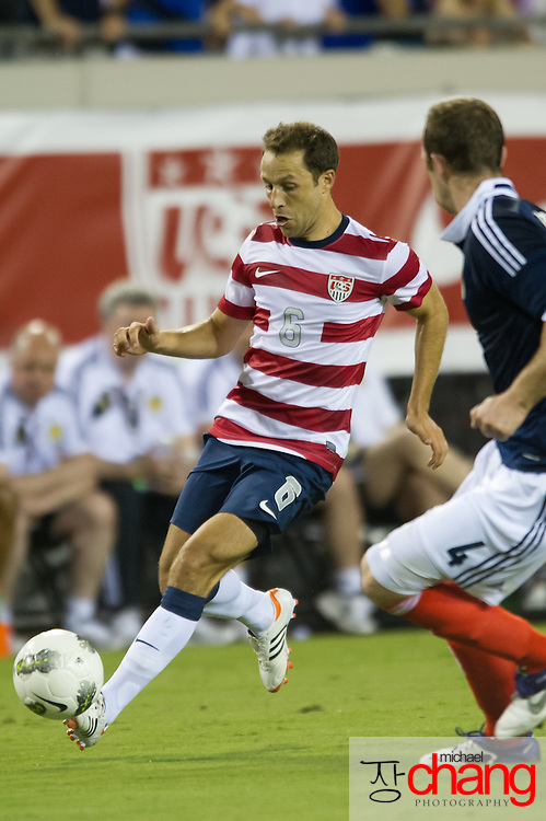 May 26 2012: USA's Steve Cherundolo (6) maneuvers around Scotland's Andy Webster (4) during the first half of play of the U.S. Men's National Soccer Team game against Scotland at Everbank Field in Jacksonville, FL. At halftime USA lead Scotland 2-1.