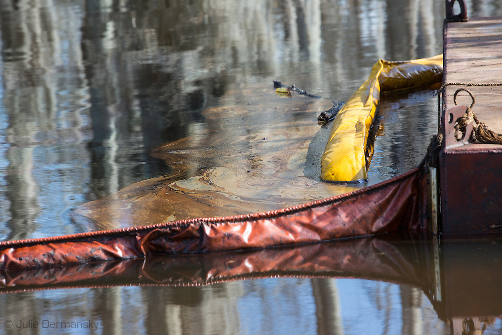 Oil coats the surface of the sinkhole near the site of the collapsed  Texas Brines Salt Cavern in Bayou Corne.