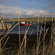 SHETLAND, SCOTLAND - APRIL 05, 2017: A boat is seen docked at Cunningsburgh pier in the main island of the Shetland arquipélago. Prompted by Brexit and the prospect of a second independence referendum for Scotland, the fiercely independent Shetland Islanders are once again debating the need for more autonomy. CREDIT: Paulo Nunes dos Santos for The New York Times