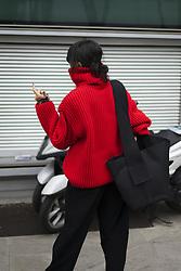 January 15, 2018 - Milan, Italy - Yoyo Lu wearing red turtleneck, black wide leg pants is seen outside Fendi during Milan Men's Fashion Week Fall/Winter 2018/19 on January 15, 2018 in Milan, Italy. (Credit Image: © Nataliya Petrova/NurPhoto via ZUMA Press)