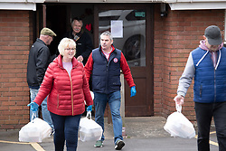 © Licensed to London News Pictures. 30/03/2020. Baddesley, North Warwickshire, UK. MP Delivery. North Warwickshire MP Craig Tracey (centre) turns delivery man to help deliver meals in his constituency. When Atherstone coffee shop owner Angie Spencer decided to make meals for people who were housebound she asked for volunteers to help deliver the meals. The local community responded along with local MP Craig Tracey. The meals will be delivered on Mondays and Fridays to start with, the first going out today (Monday 30th March) with over 100 meals being delivered. Angie has put out a request for more drivers should the need rise. Angie, a local town councillor started the idea along with business partner Stephen Reay and asked Warwickshire County Council to help with the scheme. Photo credit: Dave Warren / LNP