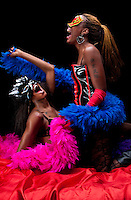 Young african american girlfriends, lesbian couple, very cheerful and playing in bed.