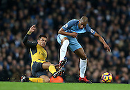 Alexis Sanchez of Arsenal tackles Fernando of Manchester City during the English Premier League match at the Etihad Stadium, Manchester. Picture date: December 18th, 2016. Picture credit should read: Simon Bellis/Sportimage