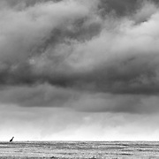 """""""Africa!""""                                                              Tanzania<br />  A Lone Giraffe silhouetted against the great expanse of the Serengeti with the storm clouds pressing in. Africa!!"""