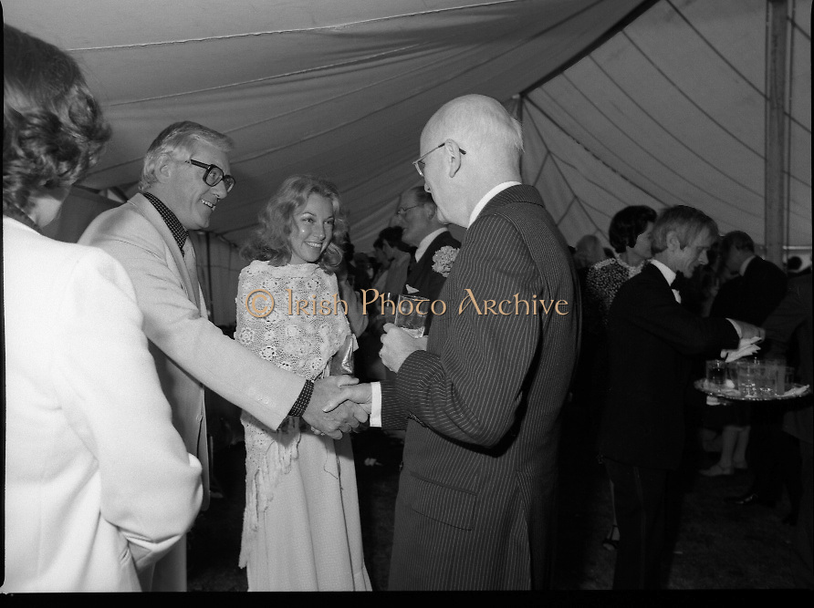 Guests and staff at the US Embassy in Phoenix Park, Dublin, celebrate American Independence Day..1980-07-04.4th July 1980.04/07/1980.07-04-80..Photographed at the US Ambassador's Residence,  Phoenix Park...US Ambassador William V Shannon shakes hands with a guest in the marquee during festivities.