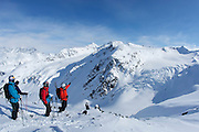 Jono Brauer and Craig Branch with guide Patton Tucker at Points North Heliskiing in Corova Alaska. MR