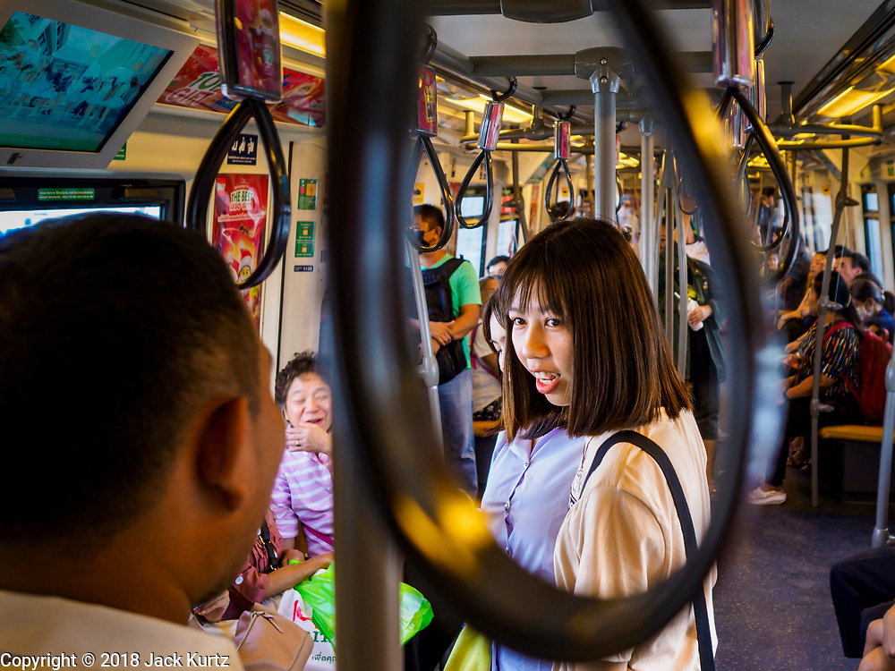 06 DECEMBER 2018 - SAMUT PRAKAN, THAILAND:Passengers ride in an already full carriage on the new east extension of the BTS Skytrain on the opening day of the extension. The 12.6 kilometer (7.8 miles) east extension of the Sukhumvit Line of the Bangkok BTS Skytrain goes into Samut Prakan, a town east of Bangkok.  The system is now 51 kilometers long (32 miles), including the 12.6 kilometer extension that opened December 06. About 900,000 people per day use the BTS.       PHOTO BY JACK KURTZ