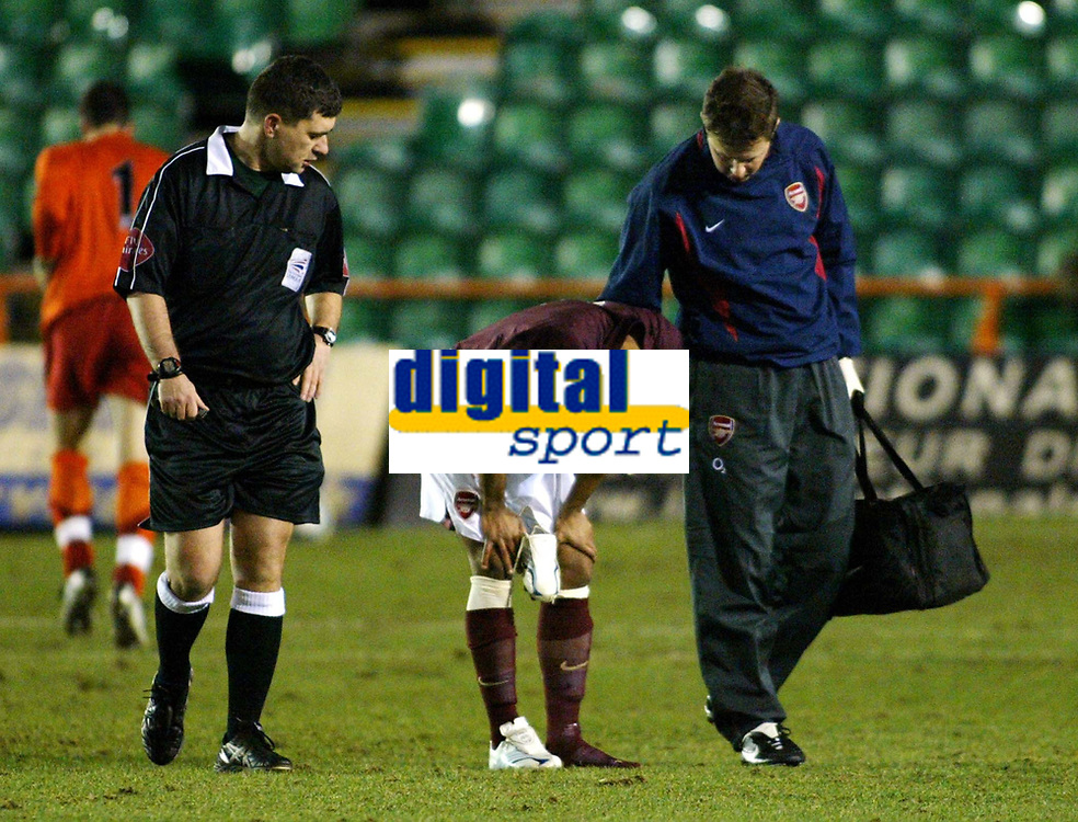 Photo: Chris Ratcliffe.<br /> Arsenal Reserves v Tottenham Hotspurs Reserves. 27/02/2006. <br /> Ashley Cole is injured again less than five minutes into his return for Arsenal reserves