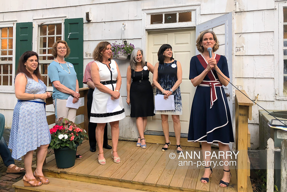 Manhasset, New York, U.S., June 8, 2018. Nassau County Executive LAURA CURRAN, at far right, speaks, with TAG Board Members to left of her, during Award Ceremony during Reception for The Art Guild exhibition held at historic Elderfields Preserve.