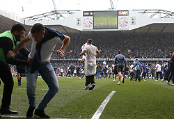 14 May 2017 London : Prmier League Football - Tottenham Hotspur v Manchester United :<br /> a steward tries in vain to stop a fan from invading the pitch.<br /> Photo: Mark Leech