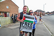 Birmingham, United Kingdom, June 14, 2021: People gathered to support Palestine Action activists who took over the rooftop of an American industrial factory known as Arconic in Birmingham on Monday, June 14, 2021. Some other activists used a sledgehammer to protest against the company who they say 'provided cladding for Grenfell Tower' and 'materials for Israel's fighter jets.' (Photo by Vudi Xhymshiti)