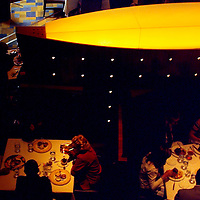 (PFEATURES) Atlantic City 10/23/2003  High Roller James Kwasnik sits with Cheldin Barlatt ( hotel PR  to left of frame) and eats dinner inside of the ______- restaurant at the Borgata Hotel and Casino.  Michael J. Treola Staff Photographer....MJT