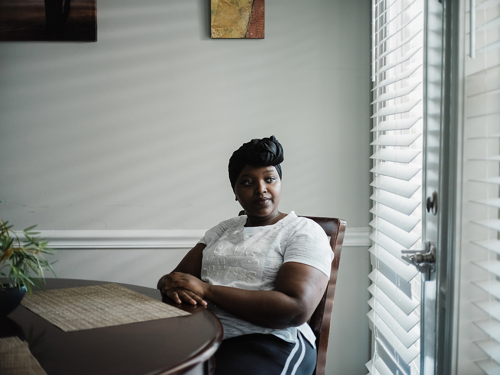 """HOOVER, AL – JULY 14, 2021: Christine Gitau, 23, sits in her cousin's apartment. Gitau has been searching for a new place to live after rent for her apartment in nearby Homewood increased by $100. """"I'm really frustrated,"""" Gitau said, """"because I feel I can't live by myself anymore. I've been trying to find something around $800 or $850 per month, but most are $1,000 or more, without utilities."""" Gitau, who moved to the United States from Kenya in 2009, works as a cashier in Homewood while attending school at nearby Jefferson State Community College.  CREDIT: Bob Miller for The New York Times"""