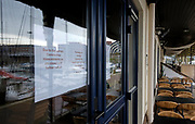 The Hague, South-Holland/Netherlands - 200318: Restaurants have to close because of the social distance measure in the hope to get the coronavirus under control.