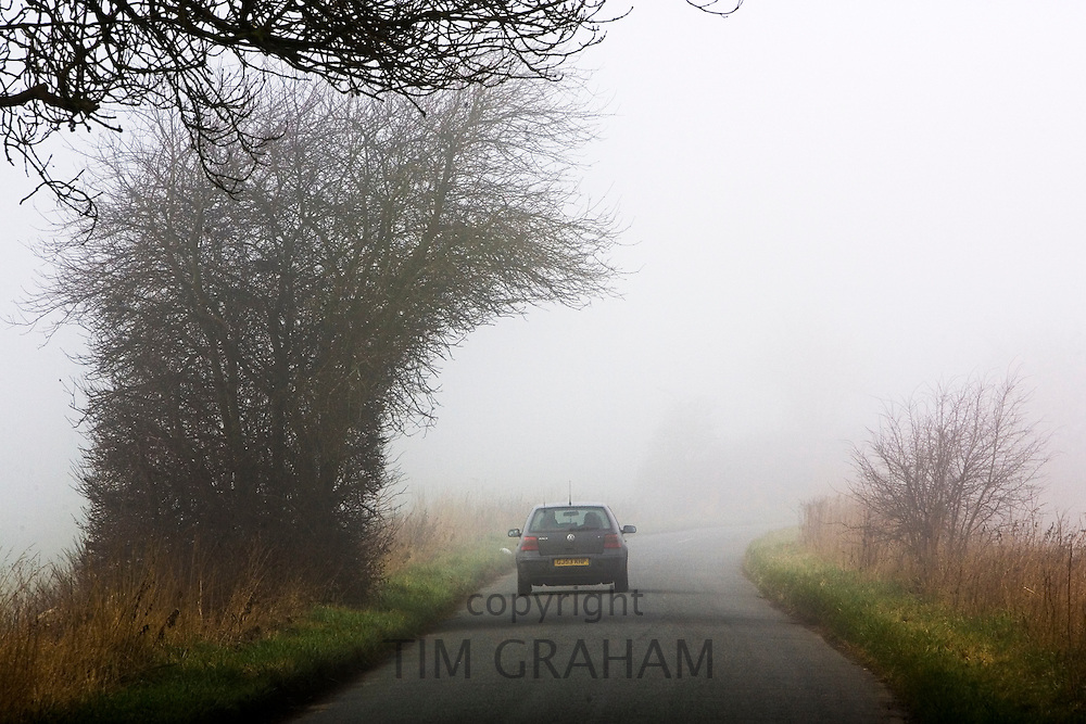 Car on deserted country lane, Gloucestershire, United Kingdom.