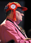© Licensed to London News Pictures. 28/09/2011. LONDON, UK. A delegate wearing a  hat carrying the slogan 'New Labour, New Britain' and badges supporting the Labour Party rests during a debate on crime at The Labour Party Conference in Liverpool today (28/09/11). Photo credit:  Stephen Simpson/LNP