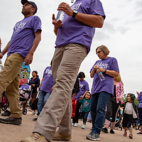 Survivors, caregivers, and family members walked in the honorary Survivor/Caregiver Walk during the opening ceremony at the Relay For Life event at the McKinley County Courthouse Square Friday evening on June 15, 2018.
