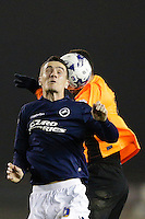 Millwall's Shaun Williams battles for possession with Brighton & Hove Albion's Leon Best<br /> <br /> Photographer Craig Mercer/CameraSport<br /> <br /> Football - The Football League Sky Bet Championship - Millwall v Brighton and Hove Albion - Tuesday 17th March 2015 - The Den - London<br /> <br /> © CameraSport - 43 Linden Ave. Countesthorpe. Leicester. England. LE8 5PG - Tel: +44 (0) 116 277 4147 - admin@camerasport.com - www.camerasport.com