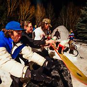 Spectators and Hostel X team members practice grabbing the beer ski during evening practice.