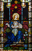 Victorian stained glass window detail Nativity scene, Everleigh church, Wiltshire, England, UK by W.T. Cleobury 1873