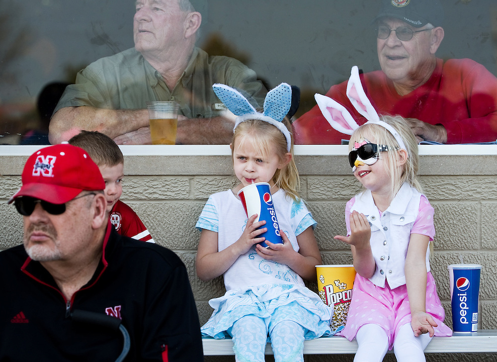 Mallory Gruwell, 5, left, and Kendal Flebbe, 4, enjoy a day at the races in their Easter outfits Saturday at Fonner Park in Grand Island. (Independent/Matt Dixon)