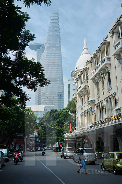 Facade of Grand Hotel Saigon With Bitexco Tower in background, Ho Chi Minh City, Vietnam, Southeast Asia