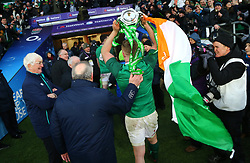Ireland's Dan Leavy takes the trophy into the changing room during the NatWest 6 Nations match at Twickenham Stadium, London.