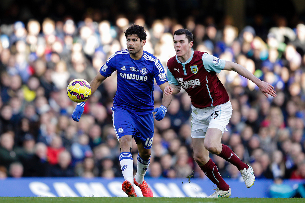 Burnley's Michael Keane vies for possession with Chelsea's Diego Costa<br /> <br /> Photographer Craig Mercer/CameraSport<br /> <br /> Football - Barclays Premiership - Chelsea v Burnley - Saturday 21st February 2015 - Stamford Bridge - London<br /> <br /> © CameraSport - 43 Linden Ave. Countesthorpe. Leicester. England. LE8 5PG - Tel: +44 (0) 116 277 4147 - admin@camerasport.com - www.camerasport.com