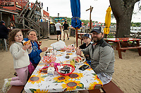 The Fanning family enjoy dinner at the Town Docks in Meredith Wednesday evening.  (Karen Bobotas/for the Laconia Daily Sun)