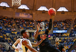 Jan 12, 2019; Morgantown, WV, USA; Oklahoma State Cowboys forward Cameron McGriff (12) drives and shoots in the lane during the first half against the West Virginia Mountaineers at WVU Coliseum. Mandatory Credit: Ben Queen-USA TODAY Sports