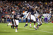 Chicago Bears outside linebacker Leonard Floyd (94) leaps and celebrates with a teammate after sacking Minnesota Vikings quarterback Sam Bradford (8) in the end zone for a first quarter safety and a 2-0 Bears lead during the 2017 NFL week 5 regular season football game against the against the Minnesota Vikings, Monday, Oct. 9, 2017 in Chicago. The Vikings won the game 20-17. (©Paul Anthony Spinelli)