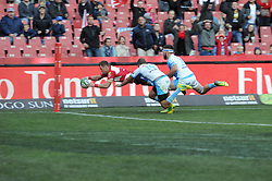 14-07-18 Johannesburg. Emirates Airlines Park. Emirates Lions vs Vodacom Blue Bulls.<br /> 2nd half. Lions right wing, Ruan Combrinck dives over the try line with Warrick Galent and Jaco Visagie trying to stop him.<br /> Picture: Karen Sandison/African News Agency (ANA)