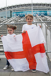 © Licensed to London News Pictures.  10/07/2021. London, UK. Two young England football supporters visit Olympic Way in Wembley Stadium ahead of the EURO 2020 final in London between England and Italy tomorrow evening (Sunday). Photo credit: Marcin Nowak/LNP