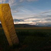 MONGOLIA. 2700+ year-old, bronze age Deer Stone at Ulaan Tolgai site near Lake Erkhel & Muren.  <br /> <br /> MS0702_060628_0435.NEF