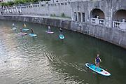 Flat boarders paddle down the Lubljanica river in the Slovenian capital, Ljubljana, on 25th June 2018, in Ljubljana, Slovenia.
