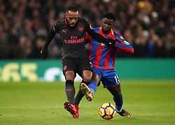 Arsenal's Alexandre Lacazette and Crystal Palace's Jeffrey Schlupp (right) battle for the ball during the Premier League match at Selhurst Park, London.