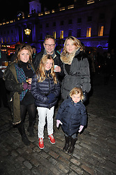 NICK JONES and KIRSTY YOUNG with their daughters L-R, NATASHA, FREYA and IONA at Skate presented by Tiffany & Co at Somerset House, London on 22nd November 2010.