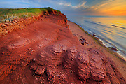 Red cliffs along Gulf of St. Lawrence at sunset