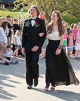 Brendan Sorrell and Melanie Crete enjoy the crowd as they march in Laconia High School's Junior Prom at Steele Hill Resort Friday evening.  (Karen Bobotas/for the Laconia Daily Sun)Laconia High School Junior Prom grand march at Steele Hill Resort Sanbornton May 13, 2011.