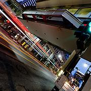 Bus motion at three-way intersection of Main St and Petticoat Lane, Kansas City, Missouri.
