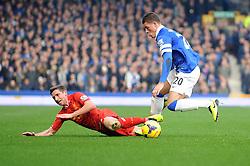 Liverpool's Joe Allen falls under a challenge from Everton's Ross Barkley - Photo mandatory by-line: Dougie Allward/JMP - Tel: Mobile: 07966 386802 23/11/2013 - SPORT - Football - Liverpool - Merseyside derby - Goodison Park - Everton v Liverpool - Barclays Premier League