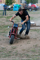 Jumping and crashing minibikes in the downtown campground that was set up for the Run to Raton. Raton, NM. USA. Saturday July 21, 2018. Photography ©2018 Michael Lichter.