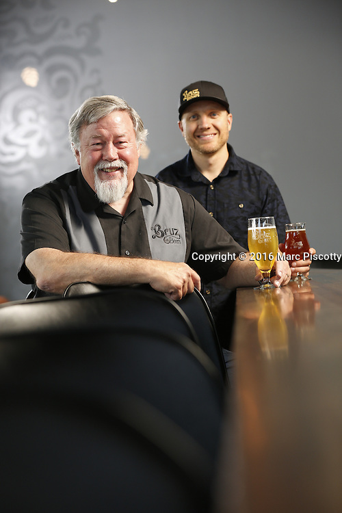 SHOT 7/22/16 2:00:48 PM - Bruz Beers co-founders Charlie Gottenkieny and Ryan Evans inside the new brewery near 67th Avenue and Pecos in Denver, Co. Bruz Beers is Denver's artisanal Belgian-style brewery, featuring a full line of traditional and Belgian-inspired brews, hand-crafted in small batches. Includes images of Evan's dog 'Cooper' as well who serves as the brewery dog. (Photo by Marc Piscotty / © 2016)